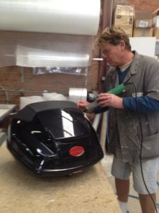 col repairing bike carier